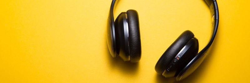 podcast cover art headphones on yellow